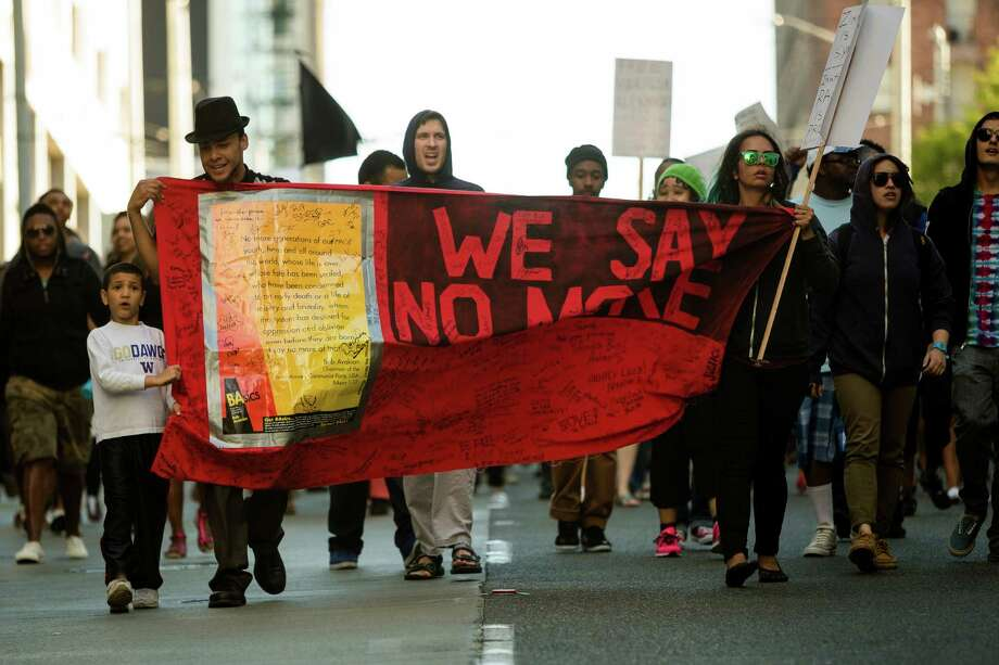 Raising chants and signs alike, Trayvon Martin supporters protested the George Zimmerman verdict. Photo: JORDAN STEAD, SEATTLEPI.COM / SEATTLEPI.COM
