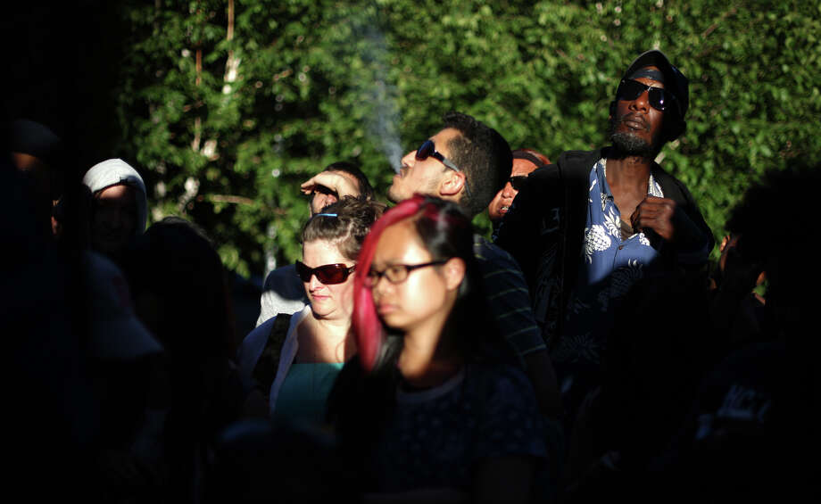 Participants listen to a speaker in front of the Federal Courthouse. Photo: JOSHUA TRUJILLO, SEATTLEPI.COM