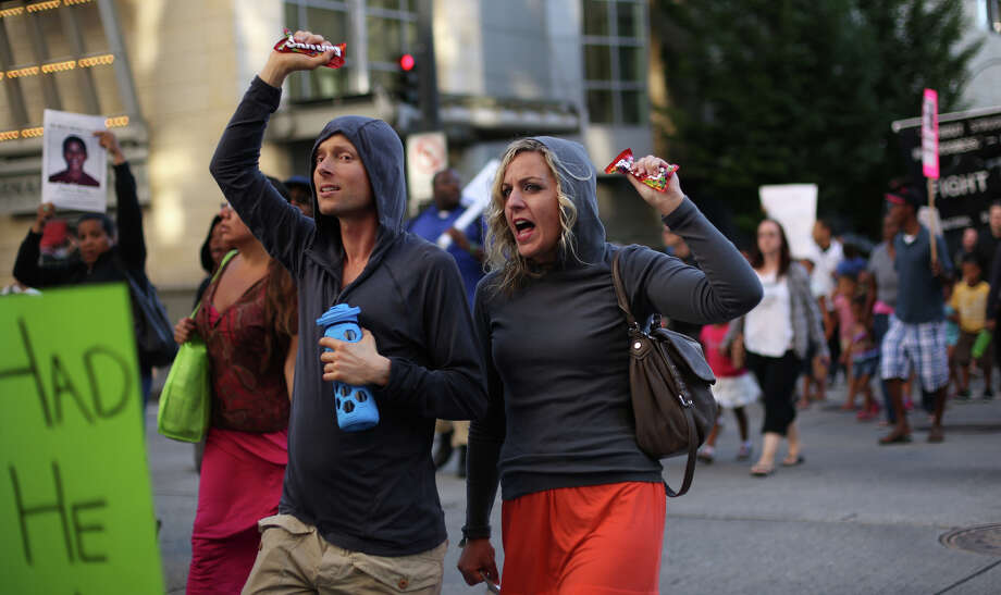 Protesters carry bags of Skittles as they march in downtown Seattle. Photo: JOSHUA TRUJILLO, SEATTLEPI.COM