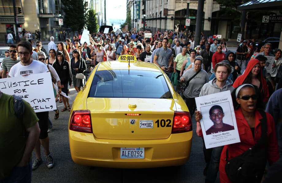 Marchers surround a taxi in downtown Seattle. Photo: JOSHUA TRUJILLO, SEATTLEPI.COM