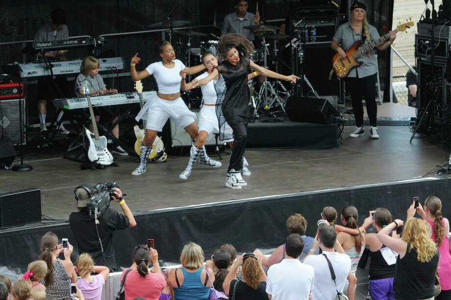 Zendaya, center, star of the Disney Channel hit series Shake It Up! performs a concert at the Saratoga Race Course during the annual Open House on Sunday, July 14, 2013 in Saratoga Springs, NY.  (Paul Buckowski / Times Union) Photo: Paul Buckowski / 00023095A