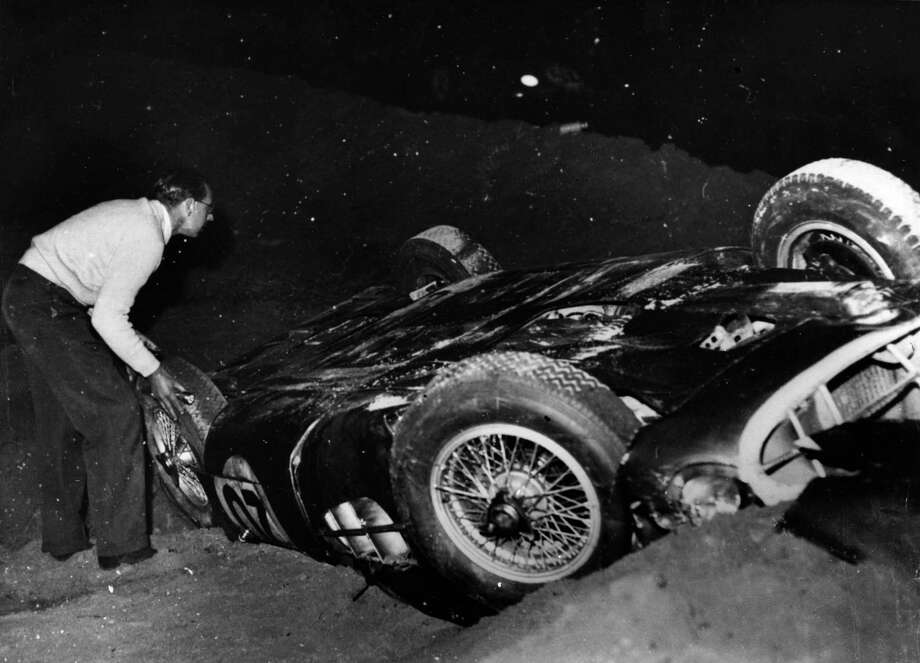 Tony Brooks' Aston Martin lying on its roof after crashing during the Le Mans 24-hour race in France. Photo: Keystone, Getty Images / Hulton Archive