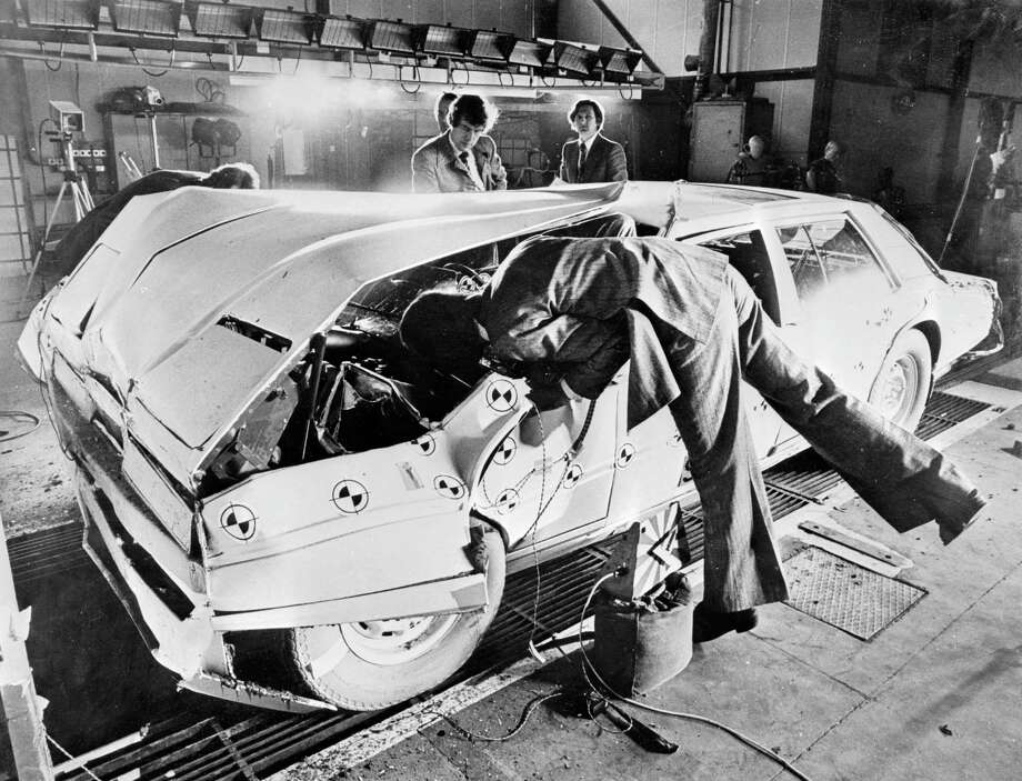 14th March 1978:  Aston Martin experts inspecting the results of a safety test on the new Aston Martin Lagonda. Photo: Keystone, Getty Images / Hulton Archive