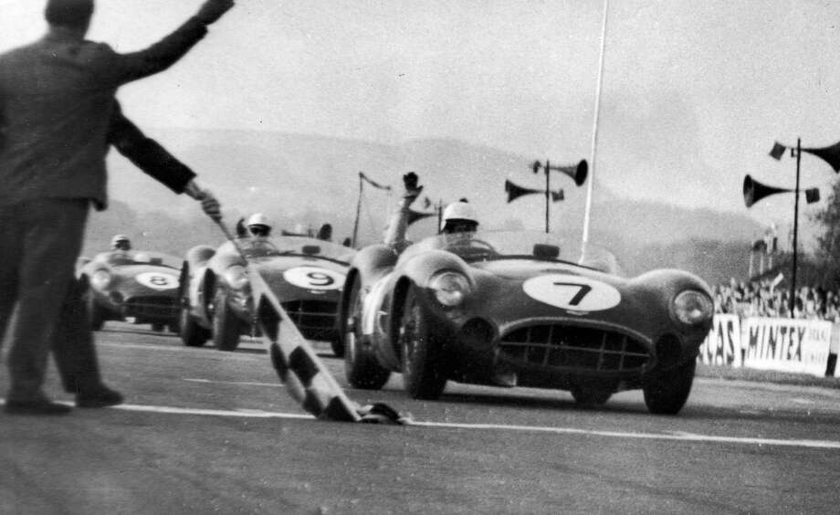 13th September 1958:  Aston Martin cars winning the top three places in the Tourist Trophy Sports Car Race at Goodwood. In first place Stirling Moss and Tony Brooks, (No 7), followed by Salvador and Jack Brabham, (No 9), and in third place, Shelby and Lewis Evans, (No 8). Photo: Keystone, Getty Images / Hulton Archive