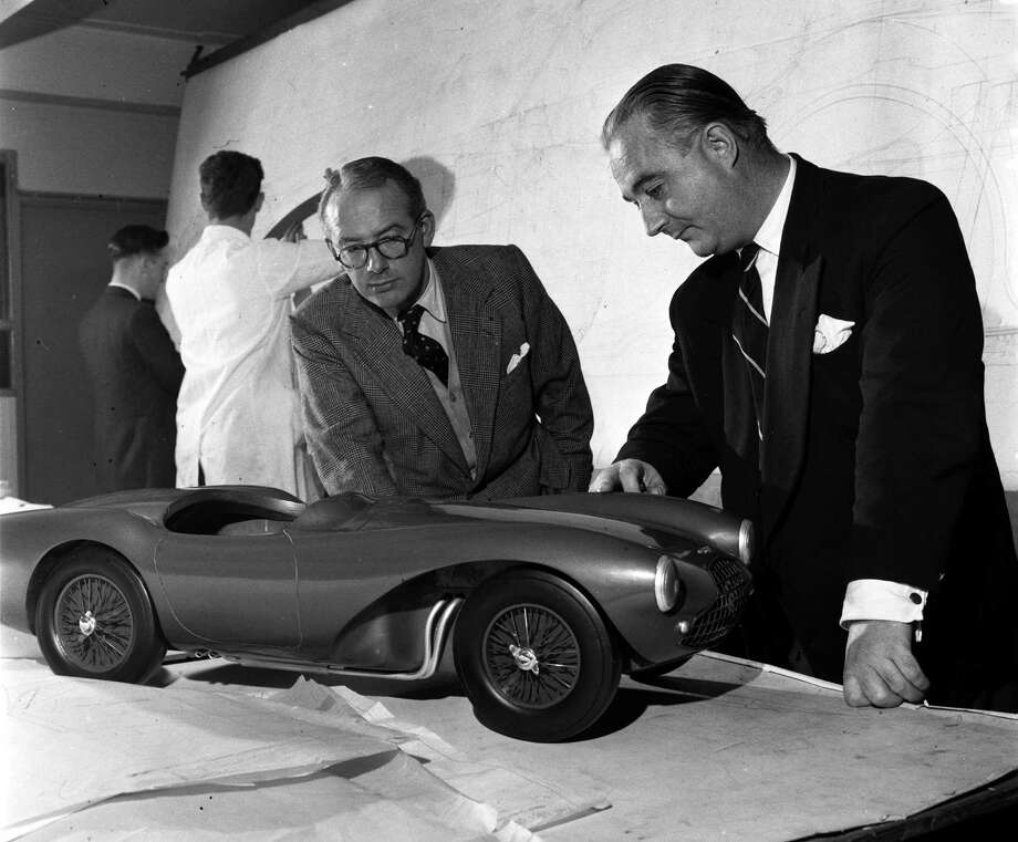 England, 1954, Millionaire David Brown (right) inspects a model of an Aston Martin motor car with Mr Frank Feeley, Aston Martin body designer Photo: Popperfoto, Getty Images / Popperfoto