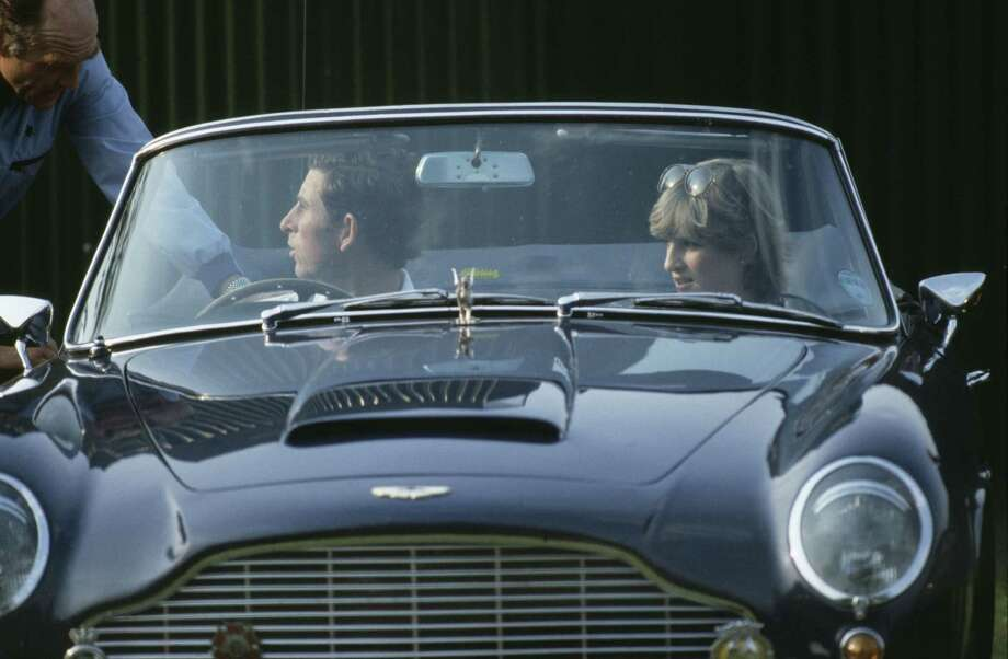 Royalty, England, Circa 1981, Prince Charles and girlfriend Lady Diana Spencer leaving a Polo match in Charles' Aston Martin sports car Photo: Bob Thomas/Popperfoto, Getty Images / Popperfoto