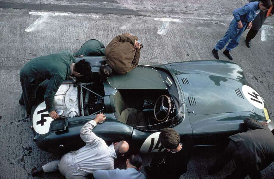 Team manager John Wyer and Tony Books joining mechanics to investiage a possible rear axle malady in the Aston Martin during the Nurburgring 1000km. Race, Nurburgring, 26th May 1957. Photo: Klemantaski Collection, Getty Images / 2007 Getty Images