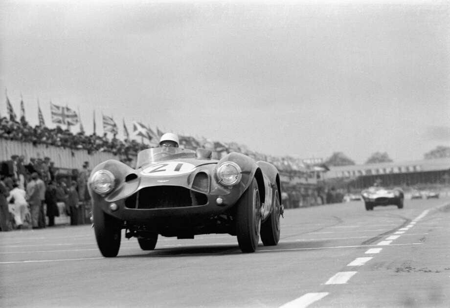 The Daily Express International Trophy; Silverstone, May 5, 1956. Stirling Moss flat out past the pits approaching Copse Corner in the works Aston Martin DB3S. He finished second to his teammate Roy Salvadori in a similar car. Photo: Klemantaski Collection, Getty Images / 2009 Getty Images
