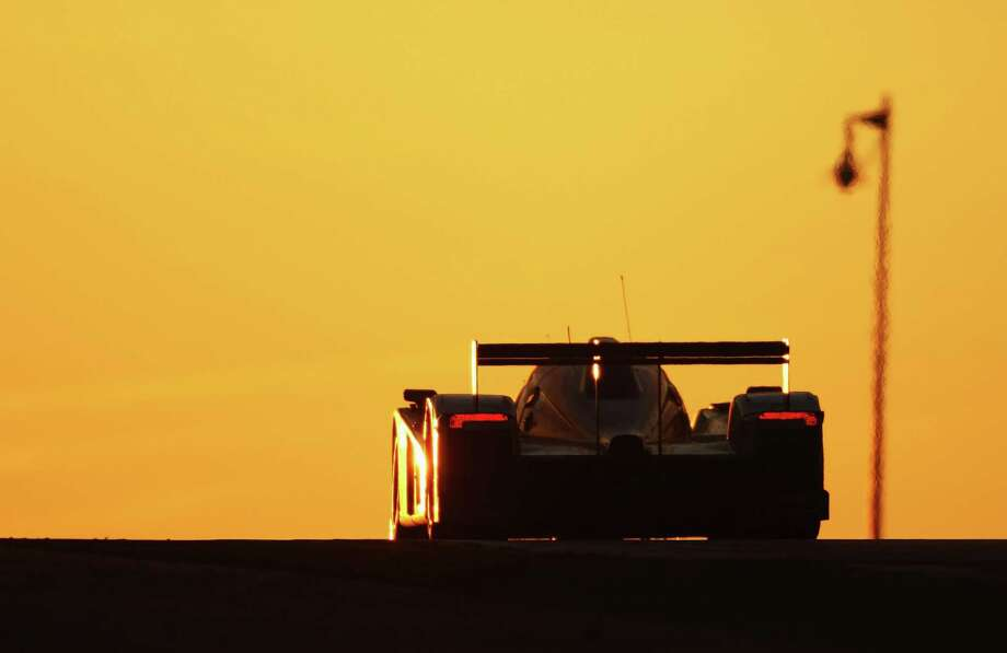 Aston Martin Racing car drives at sunrise during the 77th running of the Le Mans 24 Hour race at the Circuit des 24 Heures du Mans on June 14, 2009 in Le Mans, France. Photo: Bryn Lennon, Getty Images / 2009 Getty Images
