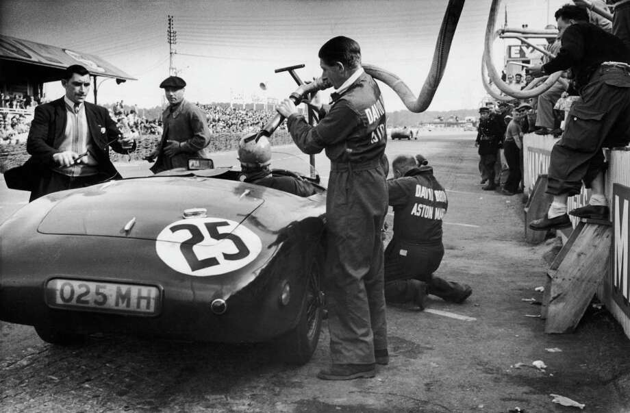 A works Aston Martin DB3 Spyder is refueled in the pits during the 24 Hours of Le Mans, at the Circuit de la Sarthe, France, 14th-15th June 1952. The car was driven by Lance Macklin and Peter Collins. Original publication: Picture Post - 5925 - How The Germans Won At Le Mans: And How We Lost - pub. 28th June 1952 Photo: Ronald Startup, Getty Images / 2009 Getty Images