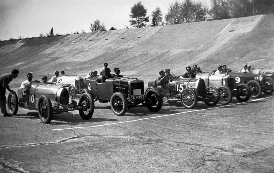 Racing cars lined up for the start of the Junior Grand Prix of the Junior Car Club's Spring Meeting. The race was won by HW Purdy driving a 1500cc Bugatti Type 37 at 55.47 mph; second was AG Frazer-Nash (1500cc Frazer Nash, 54.99 mph) and third was Hendy (750cc Austin 7, 47.7 mph). Pictured from left to right are: HW Purdy, G Newman (1100cc supercharged Salmson), an unidentified driver (1500cc Fiat), CW Johnstone (1500cc Brescia Bugatti), AG Frazer-Nash, B Eyston (1500cc Aston Martin) and BH Austin (1500cc Brescia Bugatti). Photo: Science & Society Picture Librar, Getty Images / SSPL/NMeM/Kodak Collection