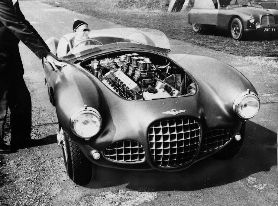 British entrepreneur Sir David Brown (1904 - 1993) at the wheel of a new 12-cylinder Lagonda racing car during trials, 22nd April 1954. Brown's company, David Brown Ltd., owns the Aston Martin and Lagonda car companies. The new Lagonda car is intended to compete at Le Mans. Photo: Keystone, Getty Images / 2009 Getty Images
