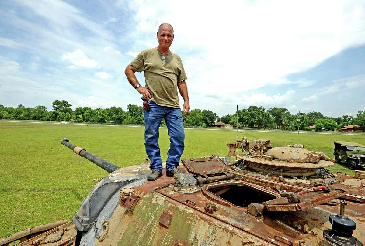Gary Giarraputo stands with his 1963 British Chieftain Mk 10 tank that is being restored in Beaumont. Photo taken on Thursday, July 11, 2013. Photo taken: Randy Edwards/The Enterprise