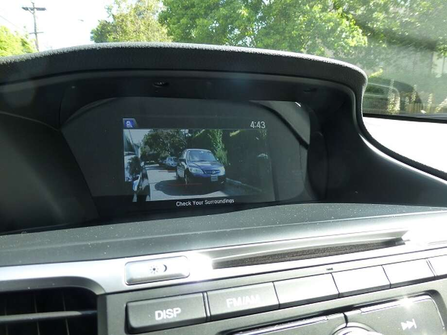 Switching on the right turn signal gives a dash-mounted screen a camera's-eye view down the right side of the car. This LaneWatch feature essentially duplicates the view in the right-door mirror.