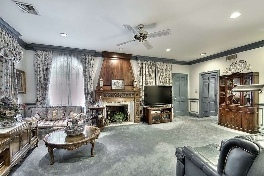 Sitting room off the master bedroom has an antique walnut country French fire place, double pocket doors to master bedroom, French doors open to outside porch,sound speakers, crown molding,chair rail & raised mill work.Sound speakers.