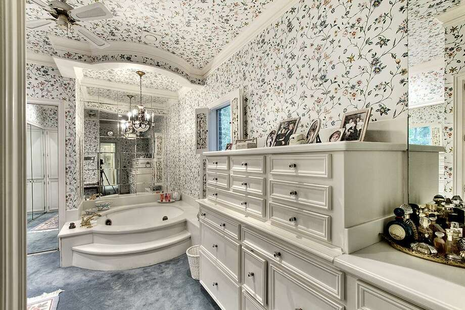 Master bath includes circular whirl pool tub, generous closets and built in storage and cabinets. Sound speakers.