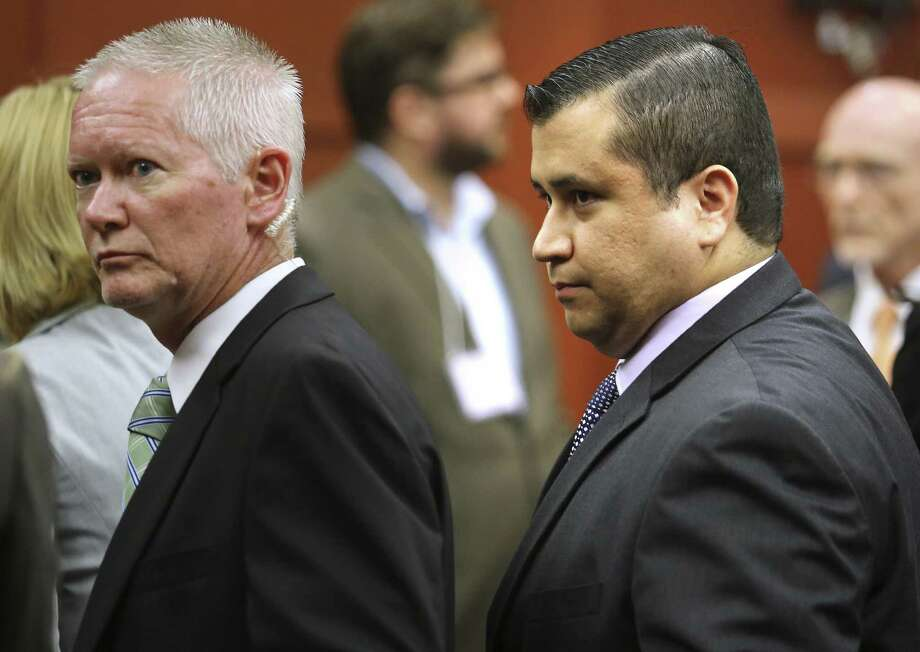 George Zimmerman (right) leaves court after his not guilty verdict was read Saturday. Readers weigh in both sides of the controversial trial. Photo: Joe Burbank, Associated Press / Orlando Sentinel POOL