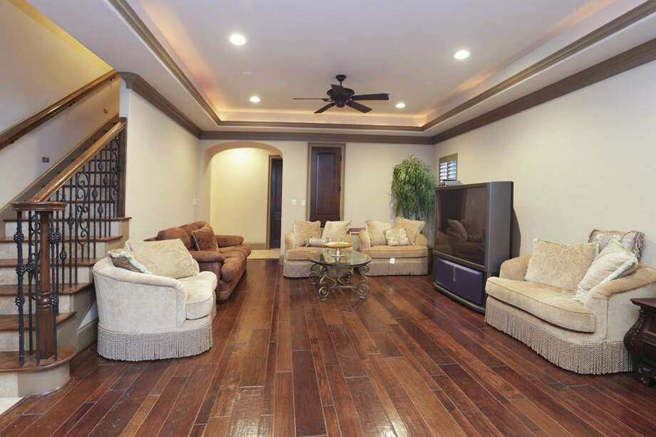 Another view of the downstairs game room which features extravagant hard wood flooring.