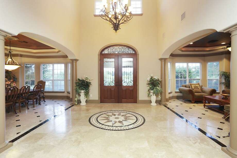 This palatial entrance displays the custom made floor medallion with exquisite marble inlays and imported stones.