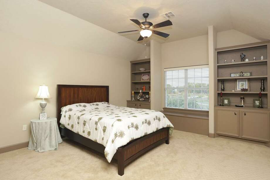 The fourth bedroom is upstairs and features a shared bath with the fifth bedroom.