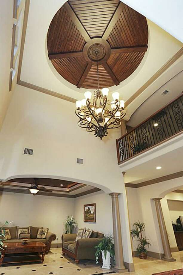 The entrance foyer dome was custom handcrafted using imported woods.