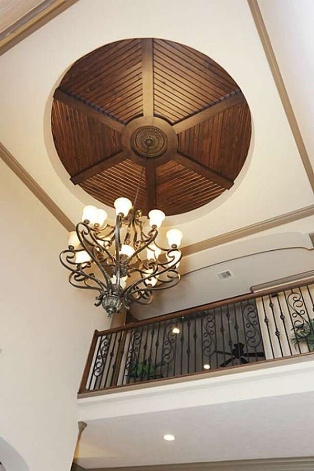 Another view of the handcrafted foyer dome with view of the bridge upstairs.