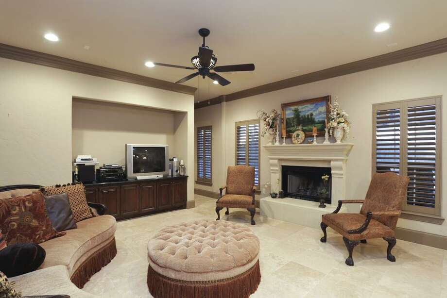 The focal point of this Great Room is the fireplace made from sand imported from the Dead Sea.