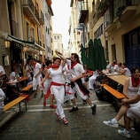 Answer 23:The Basques. The slogan refers to their dream of uniting the four Basque  provinces in Spain with the three in France to create one  Basquecountry.Here, revelers dance while musicians from Oberena play traditional Basque Country music in the street on the fifth day of the San Fermin Running Of The Bulls festival on July 10, 2013 in Pamplona, Spain.