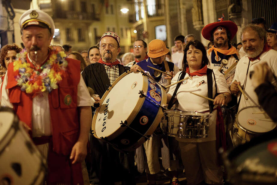A member of 'Estruendo' perform along the streets of Pamplona in the early hours ahead of El Pilar's ranch fighting bulls running on the seventh day of the San Fermin Running Of The Bulls festival on July 12, 2013 in Pamplona, Spain. The annual Fiesta de San Fermin, made famous by the 1926 novel of US writer Ernest Hemmingway 'The Sun Also Rises', involves the running of the bulls through the historic heart of Pamplona, this year for nine days from July 6-14. Photo: Pablo Blazquez Dominguez, Getty Images / 2013 Getty Images