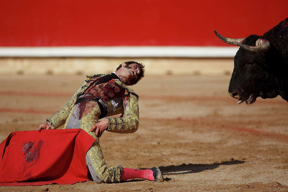 """Bullfighter Juan Jose Padilla performs with Fuente Ymbro's fighting bulls on the eighth day of the San Fermin Running Of The Bulls festival on July 13, 2013 in Pamplona, Spain. The annual Fiesta de San Fermin, made famous by the 1926 novel of U.S. writer Ernest Hemmingway """"The Sun Also Rises,"""" involves the running of the bulls through the historic heart of Pamplona, this year for nine days from July 6-14. Photo: Pablo Blazquez Dominguez, Getty Images / 2013 Getty Images"""