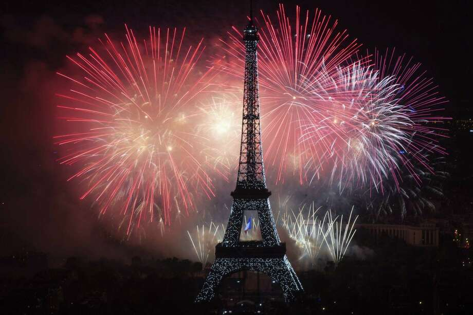 TOPSHOTS Fireworks burst around the Eiffel Tower in Paris on July 14, 2013 as part of France's annual Bastille Day celebrations.  AFP PHOTO / FRED DUFOURFRED DUFOUR/AFP/Getty Images ORG XMIT: FRANCE-BA Photo: FRED DUFOUR, Getty / AFP