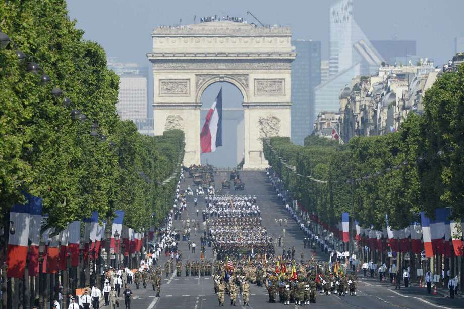 TOPSHOTS Members of the international forces that fought in Mali march down the Champs-Elysees avenue during the Bastille Day parade on July 14, 2013 in Paris.   AFP PHOTO / LIONEL BONAVENTURELIONEL BONAVENTURE/AFP/Getty Images ORG XMIT: 1 Photo: LIONEL BONAVENTURE, Getty / AFP