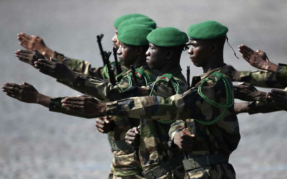 TOPSHOTS Malian troops march during the Bastille Day parade on the Champs Elysees, on July 14, 2013 in Paris.   AFP PHOTO / FRED DUFOURFRED DUFOUR/AFP/Getty Images Photo: FRED DUFOUR, Getty / AFP