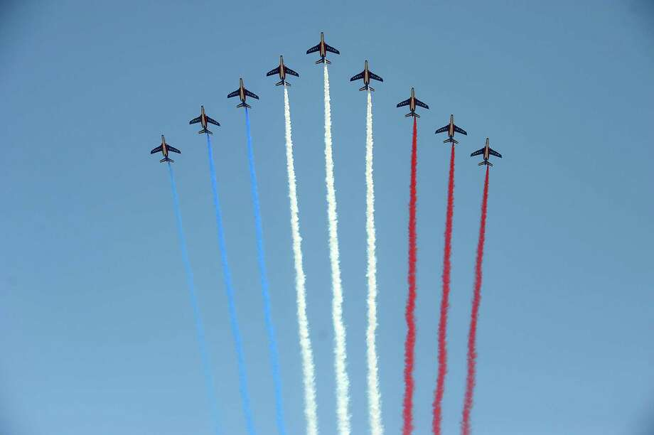 PARIS, FRANCE - JULY 14: French Air Force Patrouille de France fly over during the Bastille Day parade on the Champs Elysees on July 14, 2013 in Paris, France. The annual military ceremony is the largest in Europe remembering the 'Fete de la Federation' for 1790.  (Photo by Antoine Antoniol/Getty Images) ORG XMIT: 173728117 Photo: Antoine Antoniol, Getty / 2013 Getty Images