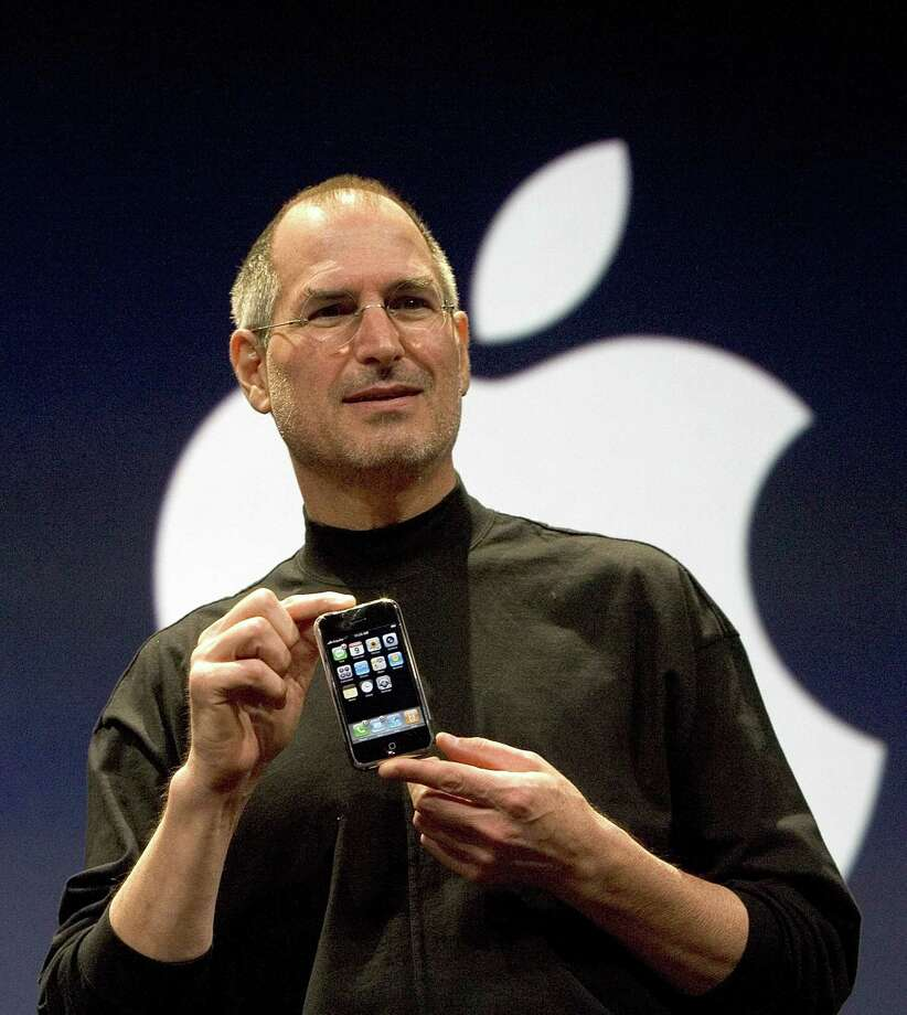 SAN FRANCISCO, CA - FILE: Apple CEO Steve Jobs holds up the new iPhone that was introduced at Macworld on January 9, 2007 in San Francisco, California. Jobs, 56, passed away October 5, 2011 after a long battle with pancreatic cancer. Jobs co-founded Apple in 1976 and is credited, along with Steve Wozniak, with marketing the world's first personal computer in addition to the popular iPod, iPhone and iPad. (Photo by David Paul Morris/Getty Images) Photo: David Paul Morris, Stringer / 2007 Getty Images