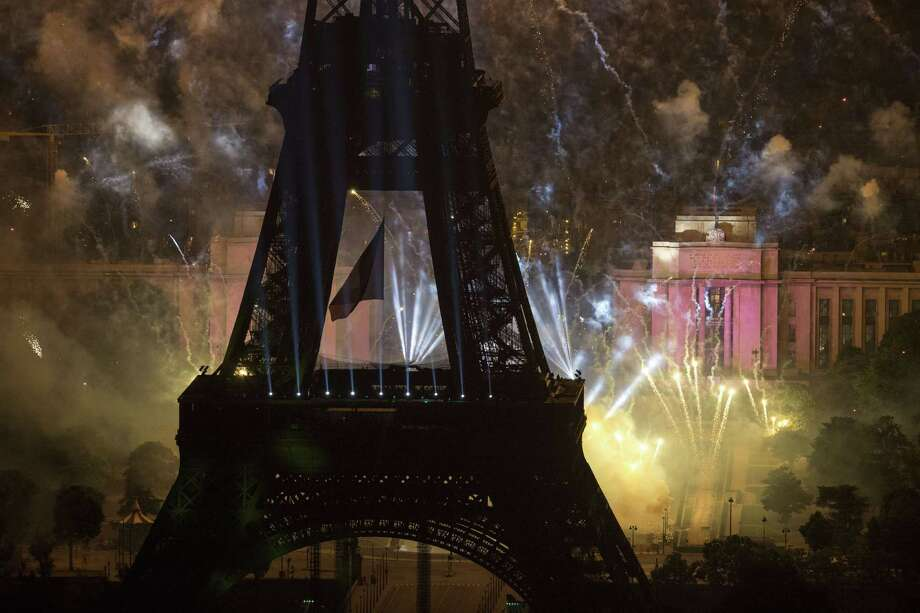 Fireworks burst around the Eiffel Tower in Paris on July 14, 2013 as part of France's annual Bastille Day celebrations.  AFP PHOTO / FRED DUFOURFRED DUFOUR/AFP/Getty Images ORG XMIT: FRANCE-BA Photo: FRED DUFOUR, Getty / AFP
