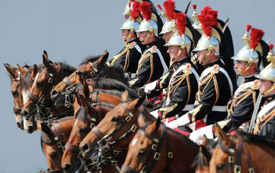 French Republican horse Guards parade during the Bastille Day in Paris Sunday, July 14, 2013. (AP Photo/Jacques Brinon) ORG XMIT: XJB107 Photo: Jacques Brinon, AP / AP