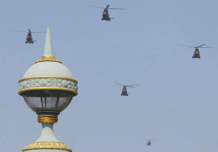 Helicopters fly in formation over the Champs Elysees avenue during a Bastille Day celebration in Paris, Sunday, July 14, 2013. (AP Photo/Jacques Brinon) ORG XMIT: XJB101 Photo: Jacques Brinon, AP / AP