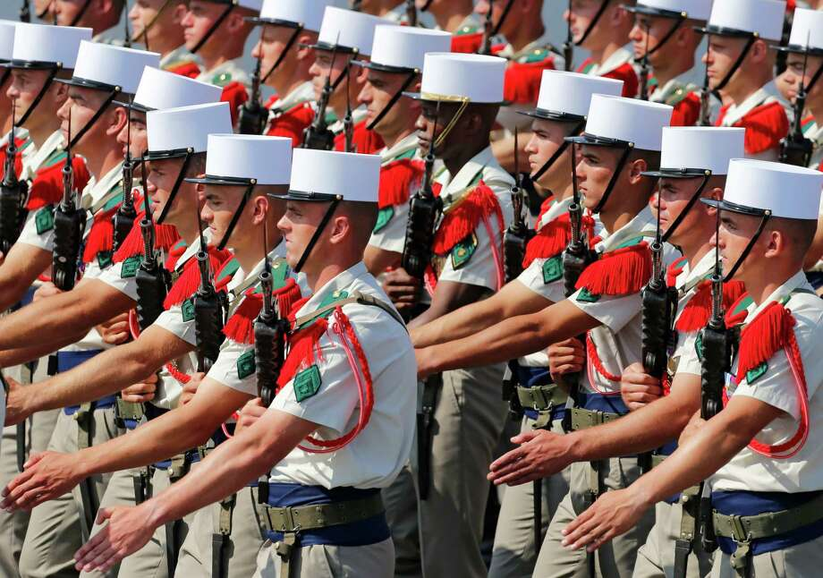 Soldiers from the Foreign Legion march during the Bastille Day parade in Paris, Sunday, July 14, 2013. Troops from 13 African countries who backed France in a war against al-Qaida-linked extremists in Mali marched with the French military during the Bastille Day parade in Paris on Sunday to honor their role in the conflict.(AP Photo/Jacques Brinon) ORG XMIT: XJB105 Photo: Jacques Brinon, AP / AP