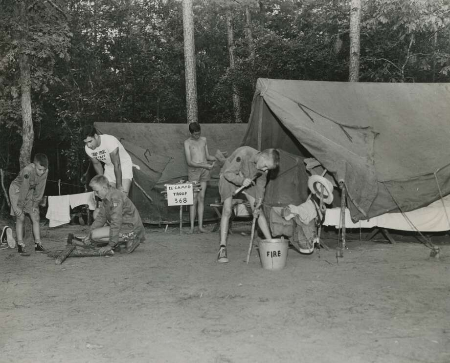 Boy Scouts with Troop 368 of El Campo set up their tents at Camp Strake in June 1950. Photo: Gunnar Liljequist Jr., Houston Chronicle