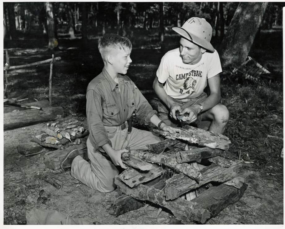 Carvel McNeil, 12, from  Pasadena, left, is taught how to properly construct a fire by James Wheat, 15, from El Campo in June 1950. Photo: Gunnar Liljequist Jr., Houston Chronicle
