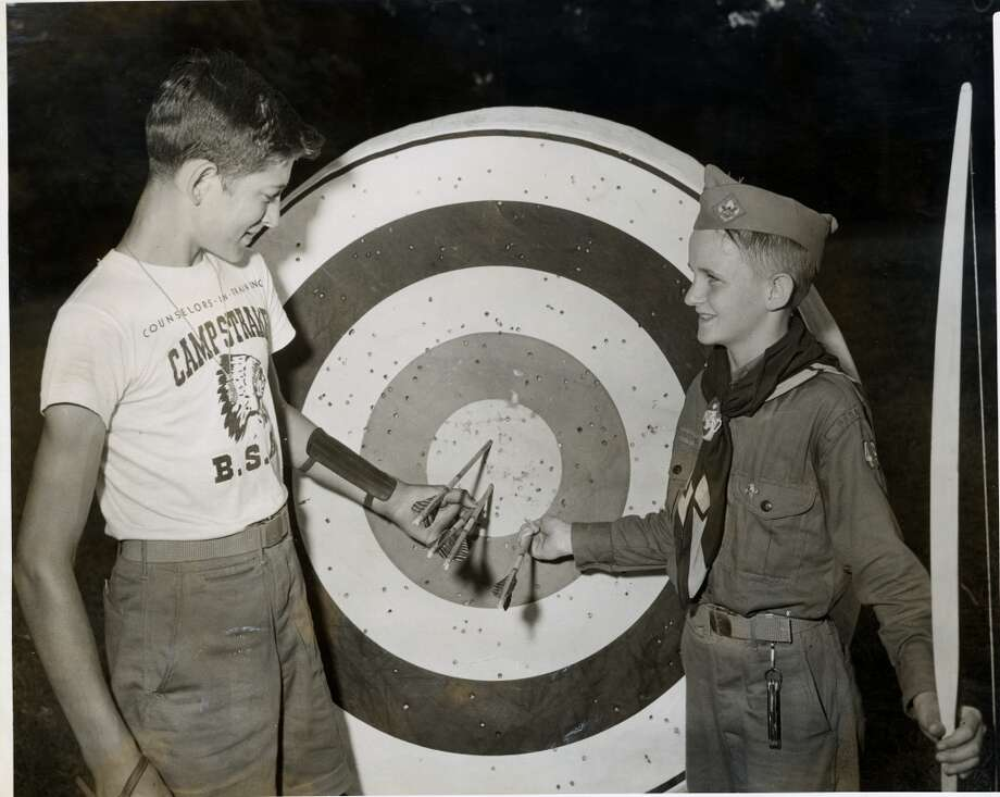 Camp counselor William Wegwert, 15, left,  shows David Smith, 12, a bulls-eye at the archery range in June 1950. Photo: Gunnar Liljequist Jr., Houston Chronicle