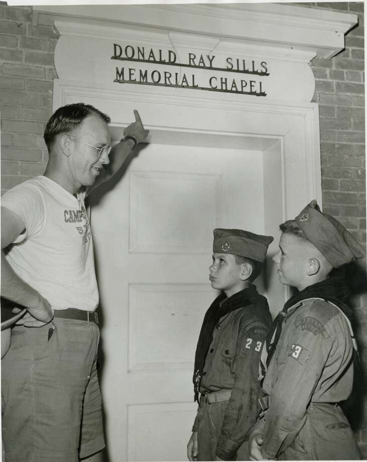 Camp director Wayne LeCrone shows the Donald Ray Sills Memorial Chapel  to two incoming scouts, Douglas Moran, 12, and Milton Wortham, 12. The chapel was named for an Eagle Scout who was killed in 1944 while serving with the naval air corps. Photo: Gunnar Liljequist Jr., Houston Chronicle