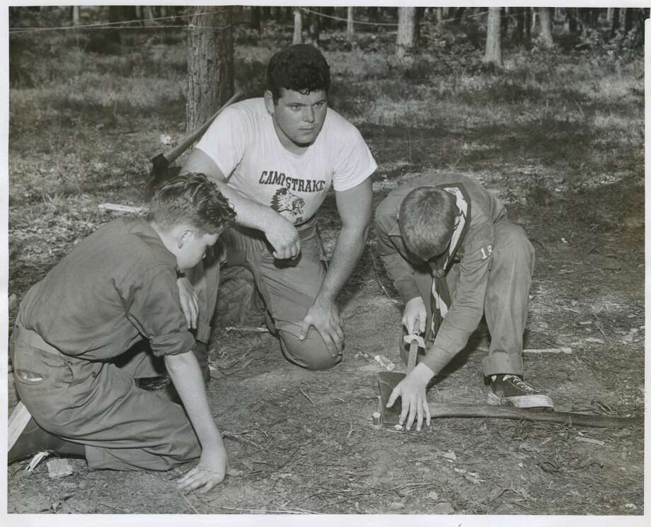 Campers are taught to sharpen an axe in June 1950. Photo: Gunnar Liljequist Jr., Houston Chronicle