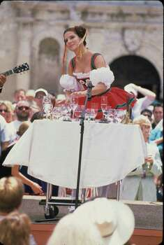 """Actress Sandra Bullock gestures while acting in front of the Alamo during the production of """"Miss Congeniality"""" on May 31, 2000. The comedy also starred Michael Caine, Candice Bergen and William Shatner. Photo: CASTLE ROCK ENTERTAINMENT"""
