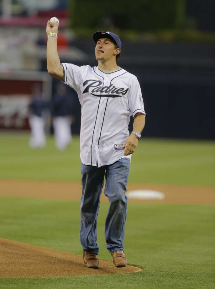 Texas A&M quarterback Johnny Manziel throws out the first pitch at a San Diego Padres game. Photo: Lenny Ignelzi, Associated Press