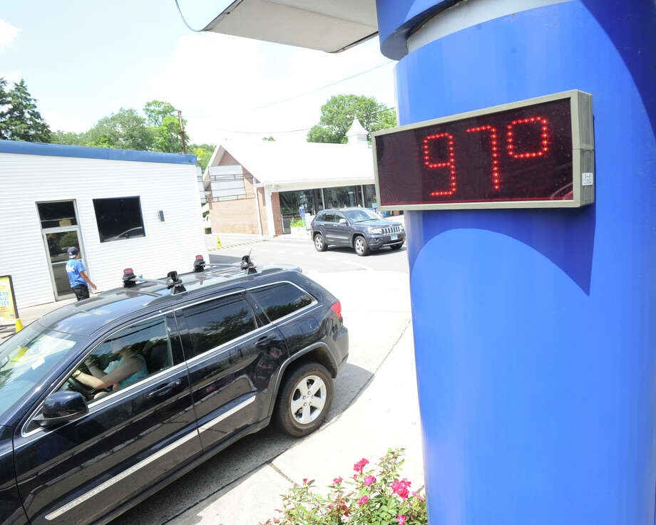 A thermometer at a Fairfield County gas station earlier this month tells what seems to be an increasingly common tale. Photo: Bob Luckey, File Photo / Greenwich Time