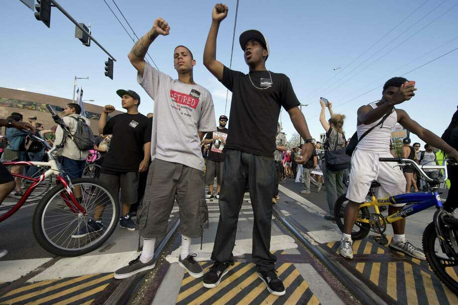 TOPSHOTS Americans angry at the acquittal of George Zimmerman in the death of black teen Trayvon Martin stand on train tracks to block trains in protest in Los Angeles, California July 14, 2013. A jury in Sanford, Florida late Saturday found Zimmerman, a volunteer neighborhood watchman, not guilty of shooting dead Martin, a 17 year-old unarmed teen on the night of February 26, 2012.  AFP PHOTO / ROBYN BECKROBYN BECK/AFP/Getty Images ORG XMIT: US-CRIME- Photo: ROBYN BECK, Getty / AFP