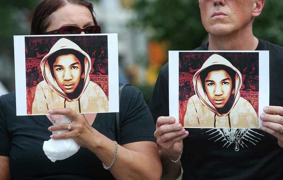NEW YORK, NY - JULY 14:  People hold photos of Trayvon Martin at a rally honoring Martin at Union Square in Manhattan on July 14, 2013 in New York City. George Zimmerman was acquitted of all charges in the shooting death of Martin July 13 and many protesters questioned the verdict.  (Photo by Mario Tama/Getty Images) ORG XMIT: 173735708 Photo: Mario Tama, Getty / 2013 Getty Images
