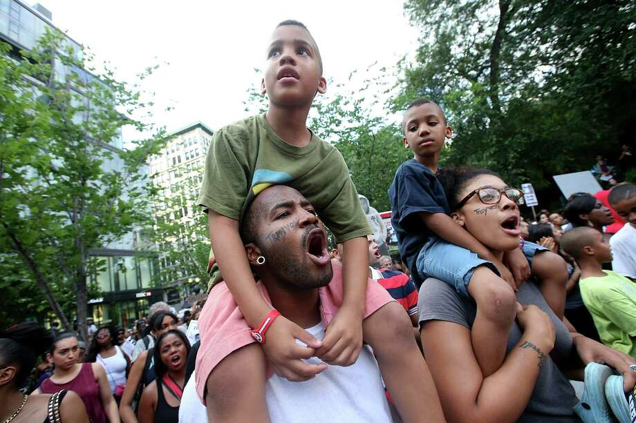 NEW YORK, NY - JULY 14:  Protesters gather at a rally honoring Trayvon Martin at Union Square in Manhattan on July 14, 2013 in New York City. George Zimmerman was acquitted of all charges in the shooting death of Martin July 13 and many protesters questioned the verdict.  (Photo by Mario Tama/Getty Images) ORG XMIT: 173735708 Photo: Mario Tama, Getty / 2013 Getty Images